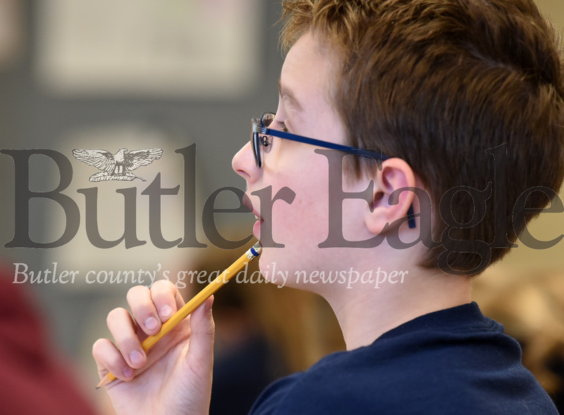 Harold Aughton/Butler Eagle: Jackson Morgus, 12, a 6th grader at Penn Christian Academy, contomplates a problem during the Friday's math olympics.