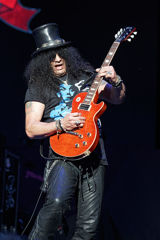 . Slash performs on Tuesday, Sept. 9, 2014, at DTE Energy Music Theatre in Independence Township. Photo by Ken Settle