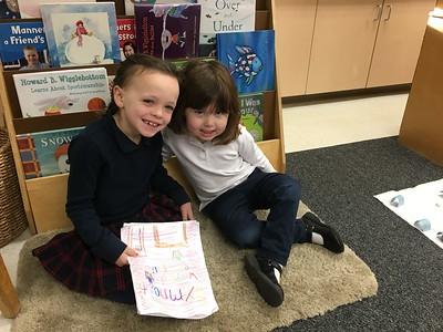 1N reads their teaching books to PreK