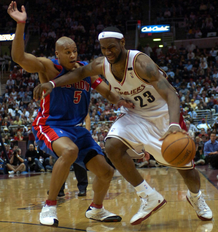 . MORNING JOURNAL/DAVID RICHARD LeBron James tries to shake defender Maurice Evans last night in the first half.