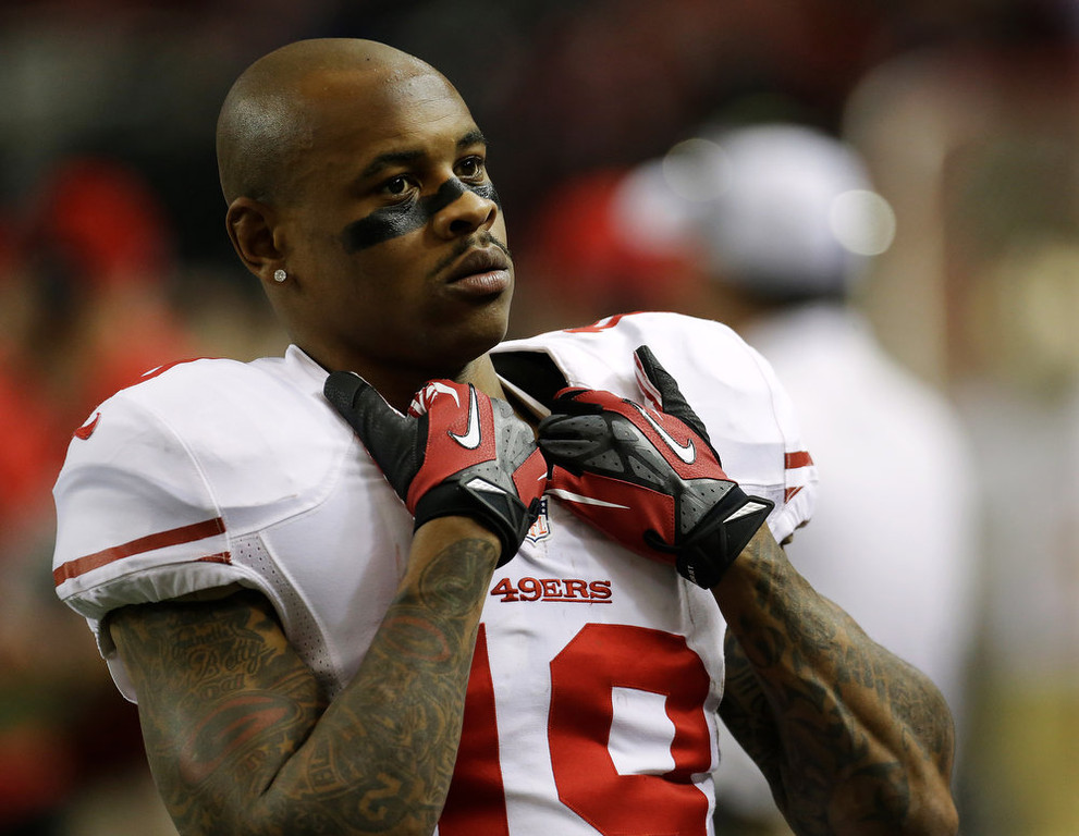 . San Francisco 49ers\' Ted Ginn watches from  the sidelines during the first half of the NFL football NFC Championship game against the Atlanta Falcons Sunday, Jan. 20, 2013, in Atlanta. (AP Photo/Dave Martin)