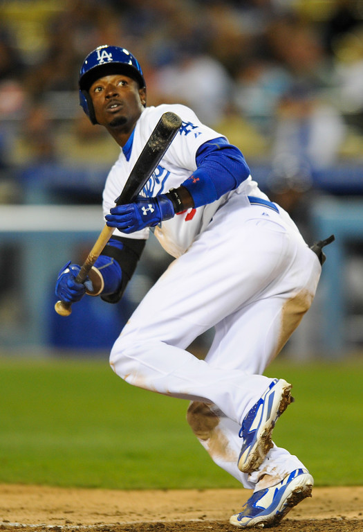 . The Dodgers\' Dee Gordon watches his bunt attempt go foul for a strikeout in the fifth inning, Friday, April 25, 2014, at Dodger Stadium. (Photo by Michael Owen Baker/L.A. Daily News)