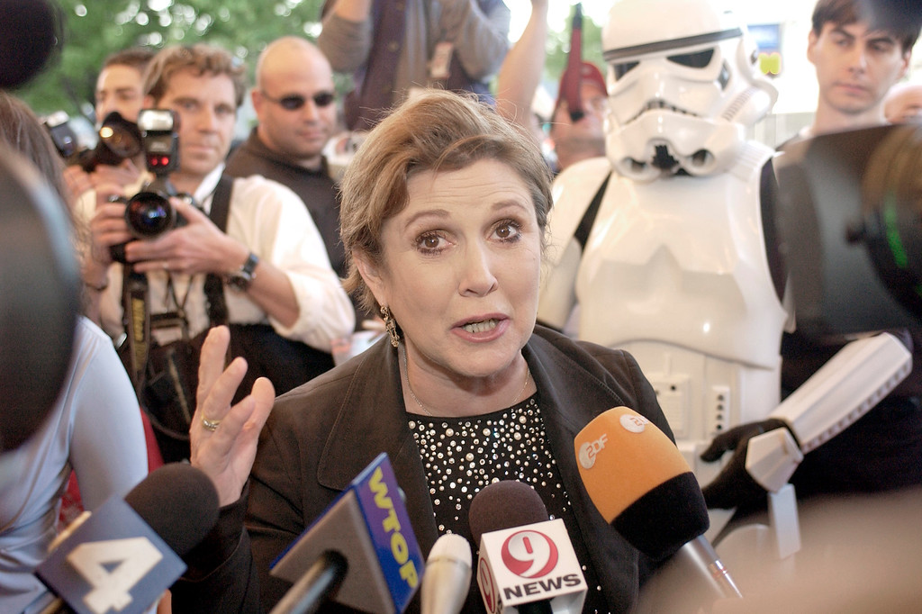 """. Original \""""Star Wars\"""" cast member Carrie Fisher speaks with the media before entering a showing of Star Wars: Episode III-Revenge of the Sith,\"""" Thursday, May 12, 2005, at the Uptown Theater in Washington. (AP Photo/Stephen J. Boitano)"""