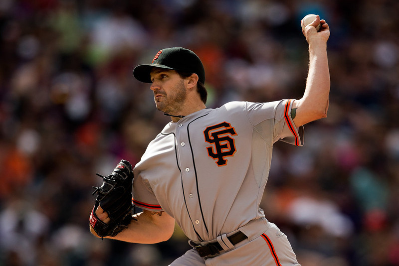 . Starting pitcher Barry Zito #75 of the San Francisco Giants delivers to home plate against the Colorado Rockies at Coors Field on May 19, 2013 in Denver, Colorado. The Rockies defeated the Giants 5-0. (Photo by Justin Edmonds/Getty Images)