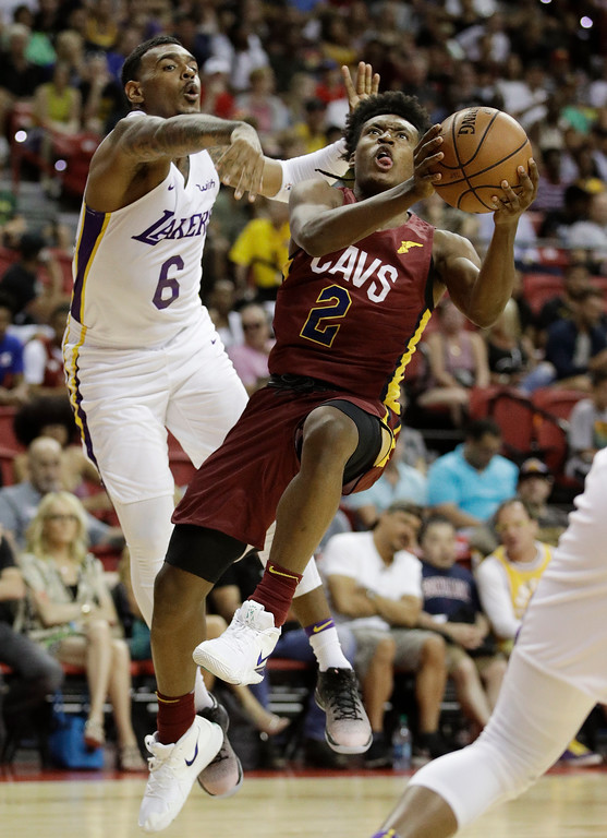 . Cleveland Cavaliers\' Collin Sexton (2) shoots around Los Angeles Lakers\' Xavier Rathan-Mayes (6) during the first half of an NBA summer league basketball game, Monday, July 16, 2018, in Las Vegas. (AP Photo/John Locher)