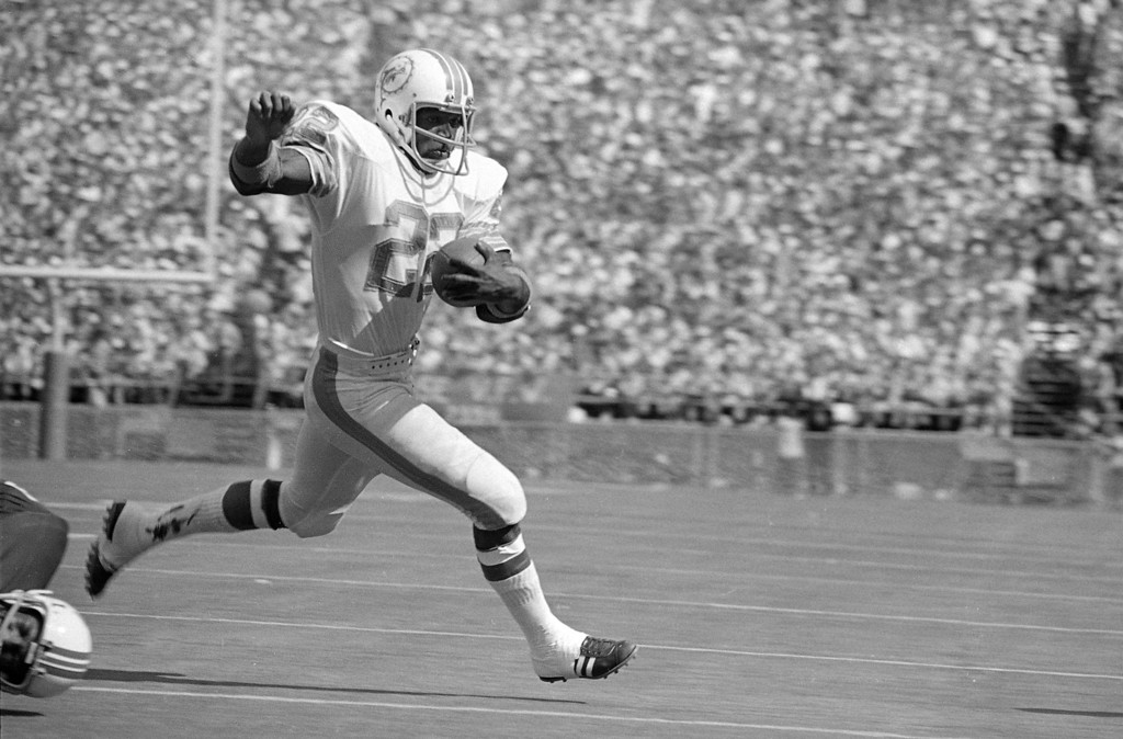 ". Miami Dolphins running back Eugene ""Mercury\"" Morris literally flies over the goal Sunday, Nov. 13, 1972 for a score against the New England Patriots, 52-0 to give coach Don Shula his 100th victory in ten years in the NFL. The game was played in Miami\'s orange Bowl. (AP Photo/Jim  Bourdier)"