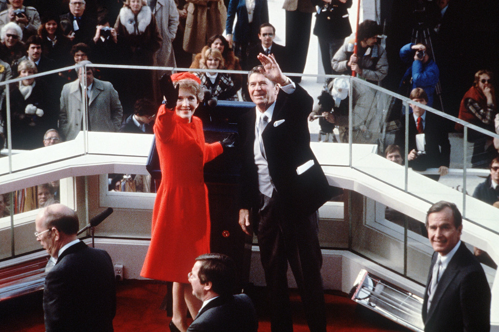 . US President Ronald Reagan (C) salutes beside his wife Nancy Reagan after being sworn in as 40th President of the United States by Chief Justice Warren Burger during inaugural ceremony, on January 20, 1981 at the Capitol in Washington, DC. At right is vice-president George W. Bush. (AFP/Getty Images)