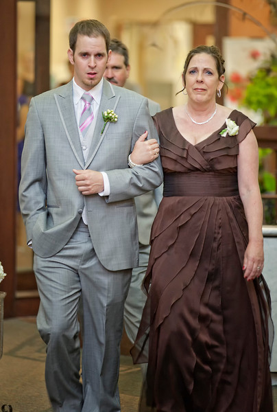 Andy walking mom down aisle.jpg