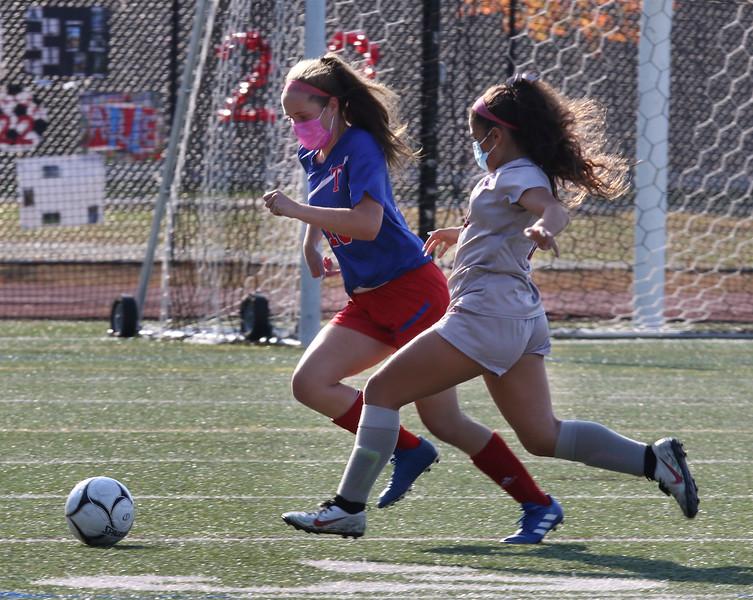 Lowell vs Tewksbury girls soccer. Tewksbury's Rachel Picher (18) and Lowell's Melissa Mejia (12). (SUN/Julia Malakie)
