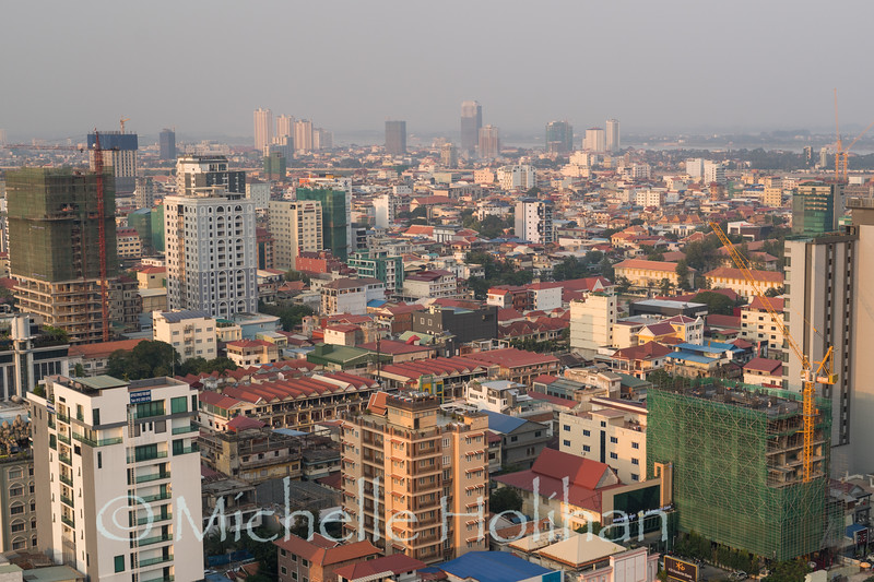 PHNOM PENH, CAMBODIA - JANUARY 30, 2019: the sun sets on a smoggy downtown Phnom Penh.