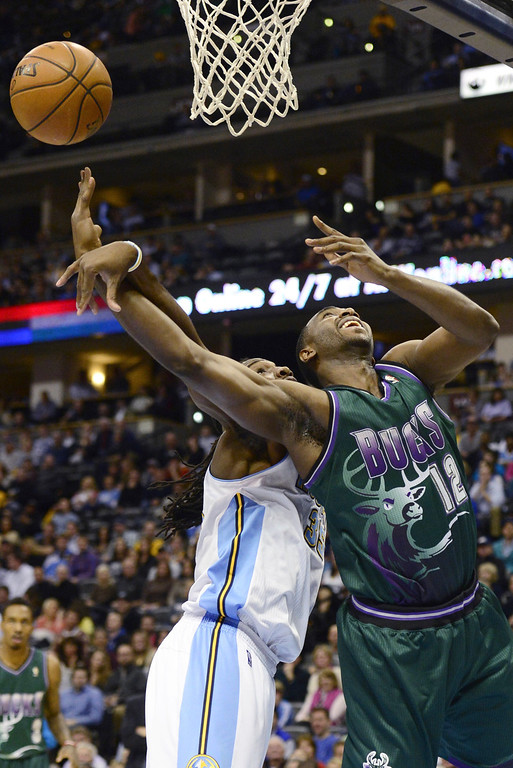. DENVER, CO - FEBRUARY 5: Kenneth Faried Denver Nuggets (35) fouls Luc Mbah A Moute (12) Milwaukee Bucks during the first half. The Denver Nuggets take on the Milwaukee Bucks in NBA action. (Photo By AAron Ontiveroz/The Denver Post)