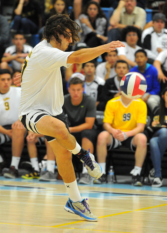 . CARSON - 04/09/2013  (Photo: Scott Varley, Los Angeles Newspaper Group)  San Pedro vs Carson boys volleyball. Carson won 3-0. In a successful soccer move, San Pedro\'s Kosta Tzavaras uses his foot to stop a spike and keep the ball alive with a perfect pass.