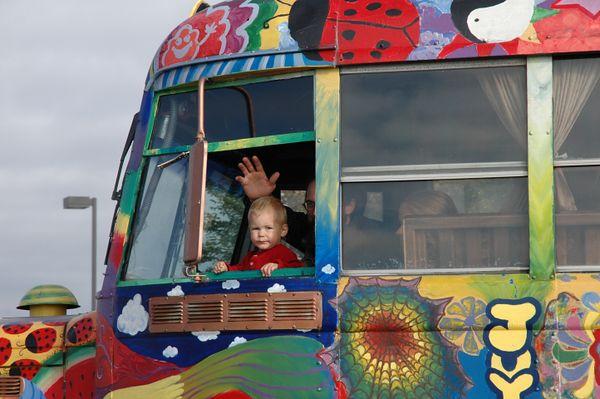 A child co-pilots the magic bus.