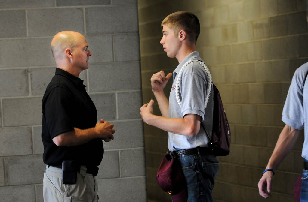 . Minnesota State Trooper Scott Kuphal, left, talks to cadets about how to take initiative during the 13 minutes they had before they marched to another class. (Pioneer Press: Jean Pieri)