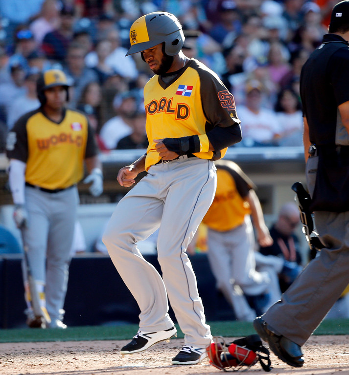 . World Team\'s Manuel Margot, of the San Diego Padres, scores on an RBI by teammate Josh Naylor, of the Mia Marlins, the All-Star Futures baseball game, Sunday, July 10, 2016, in San Diego. (AP Photo/Lenny Ignelzi)