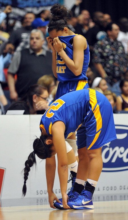 . Bishop Amat players react to their loss to Canyon Springs in the CIF-SS Division 1A girls basketball finals at the Anaheim Arena on Friday February 28, 2013. Canyon Springs beat Bishop Amat 48-46. (SGVN/Staff Photo by Keith Durflinger)