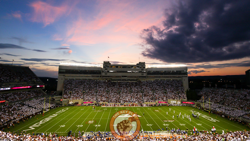 Lane Stadium sits under the lights as the sun sets over Blacksburg. (Mark Umansky/TheKeyPlay.com)