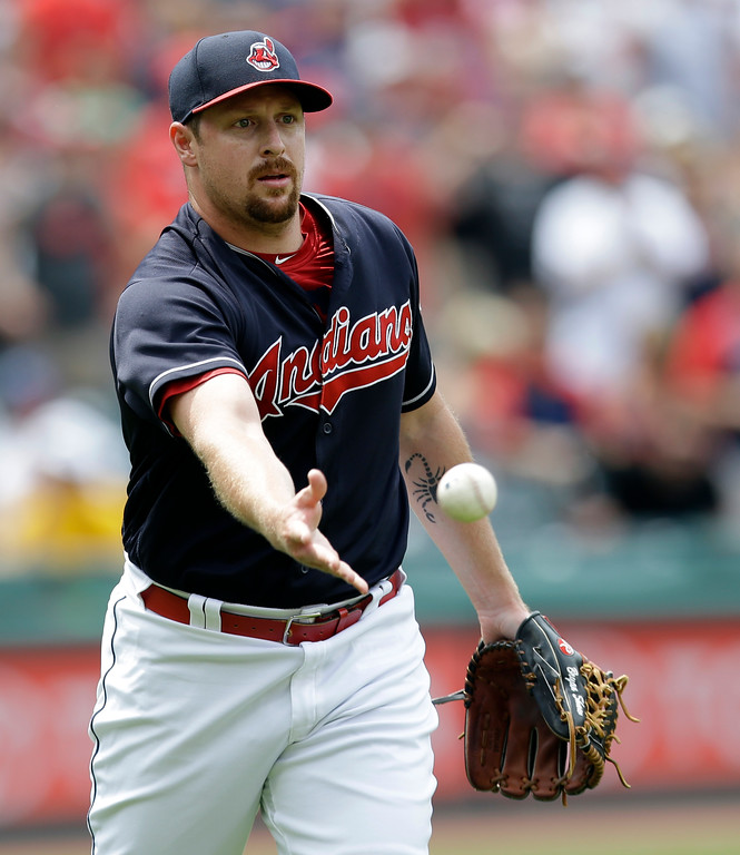 . Cleveland Indians relief pitcher Bryan Shaw tosses the ball to first base to get Texas Rangers\' Adrian Beltre in the ninth inning of a baseball game, Thursday, June 29, 2017, in Cleveland. Beltre was out on the play. The Indians won 5-1. (AP Photo/Tony Dejak)