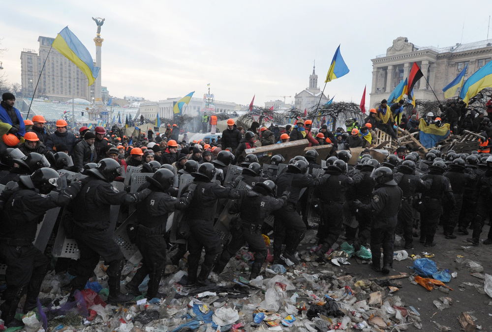 . Anti-Yanukovych protesters clash with anti-riot police on Independence Square in Kiev, on December 11, 2013. Ukrainian security forces pulled out of the epicentre of mass protests in Kiev today after a nine hour standoff with thousands of demonstrators, in a major boost for the opposition to President Viktor Yanukovych. VIKTOR DRACHEV/AFP/Getty Images