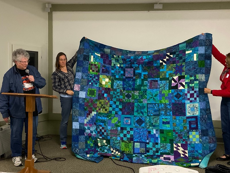 Barbara Obst also made this king size quilt made for her daughter and her husband as an anniversary quilt.  It began as a BOM from country stitches.  Quilted by Lorraine Johnson