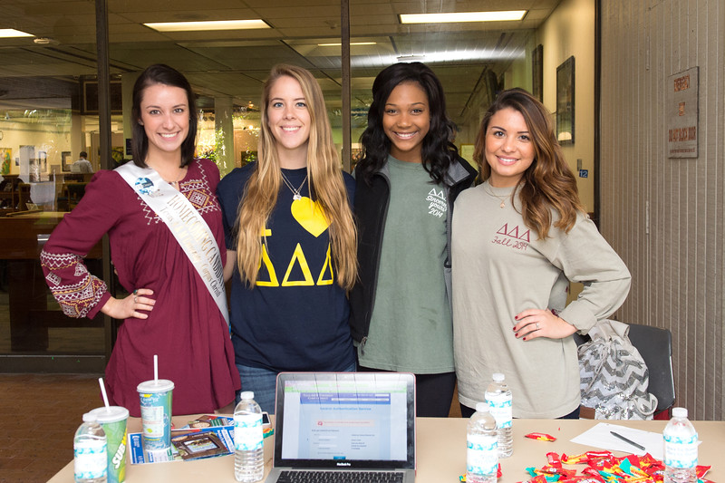 Grace Brahler(left) Brynn Putnam, Taylor Cope and Renee Lenhart ask for homecoming votes in the spine on campus.