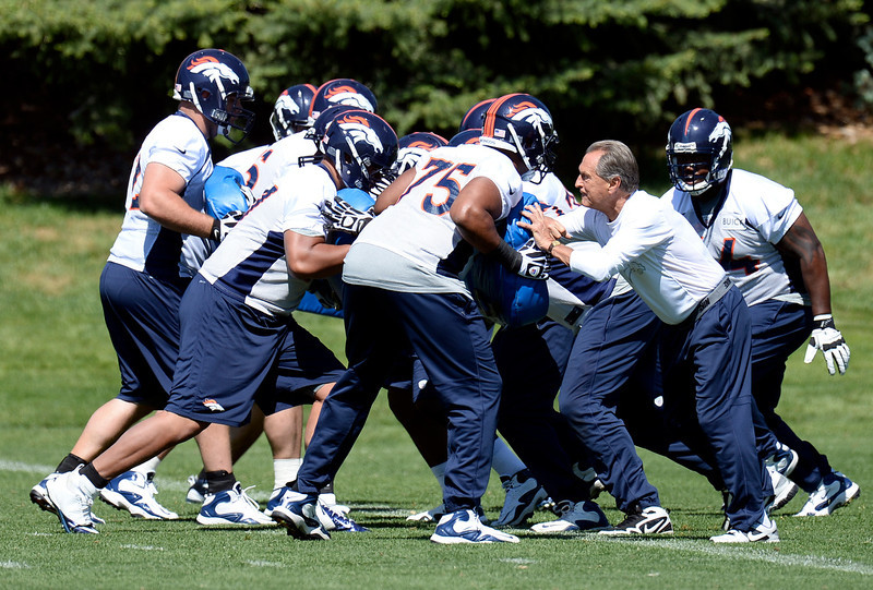 . Offensive line consultant Alex Gibbs works with the offensive line during OTAs June 6, 2013 at Dove Valley. (Photo By John Leyba/The Denver Post)