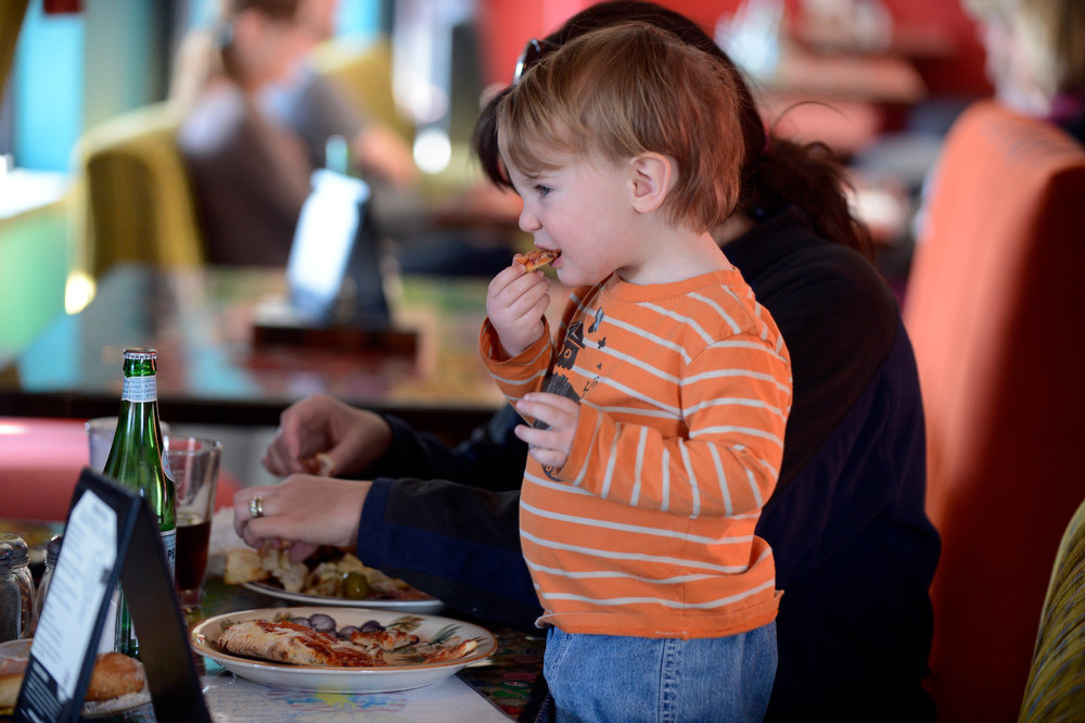 . DENVER, CO. - JANUARY 20:  Waker Anderson 2-years-old takes a  bite of his pepperoni during lunch at Pasquini\'s January 20, 2013 in Denver. The story is about kid-friendly places to eat that also please adults. (Photo By John Leyba / The Denver Post)
