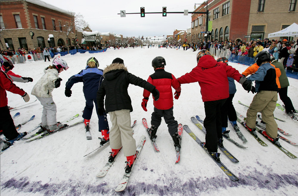. STEAMBOAT SPRINGS, CO - FEBRUARY 09:  Young skiers leave the starting line for the 50 yard dash down Lincoln Avenue during the Street Events at the 95th Annual Steamboat Springs Winter Carnival on February 9, 2008 in Steamboat Springs, Colorado. Hosted by the Steamboat Springs Winter Sports Club the winter carnival is an annual competition featuring racing, ski jumping, various snow-related events held on the main street and the Lighted Man. Started in 1914 and held for several days in February in northwest Colorado, the town of Steamboat Springs is taken over by snow lovers, ranchers, cowboys, the young and old who come together to show visitors how winter is celebrated.  (Photo by Doug Pensinger/Getty Images)