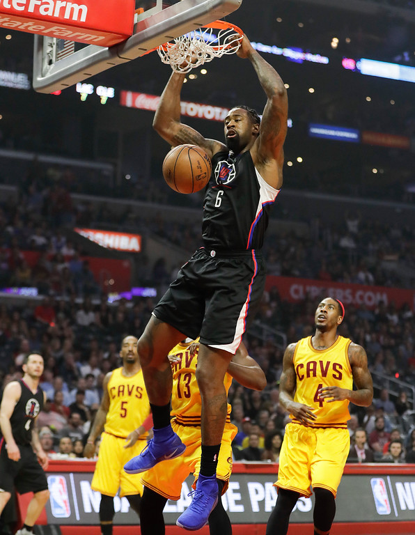 . Los Angeles Clippers\' DeAndre Jordan dunks as Cleveland Cavaliers\' Iman Shumpert, bottom right, looks on during the first half of an NBA basketball game Saturday, March 18, 2017, in Los Angeles. (AP Photo/Jae C. Hong)