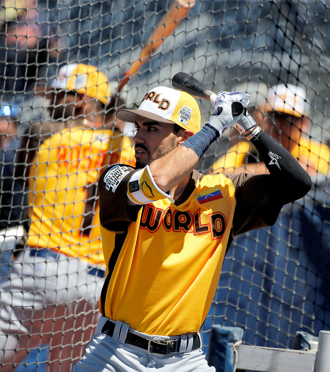 . World Team\'s Carlos Asuaje (2), of the San Diego Padres, warms up prior to the All-Star Futures baseball game against the U.S. Team, Sunday, July 10, 2016, in San Diego. (AP Photo/Lenny Ignelzi)