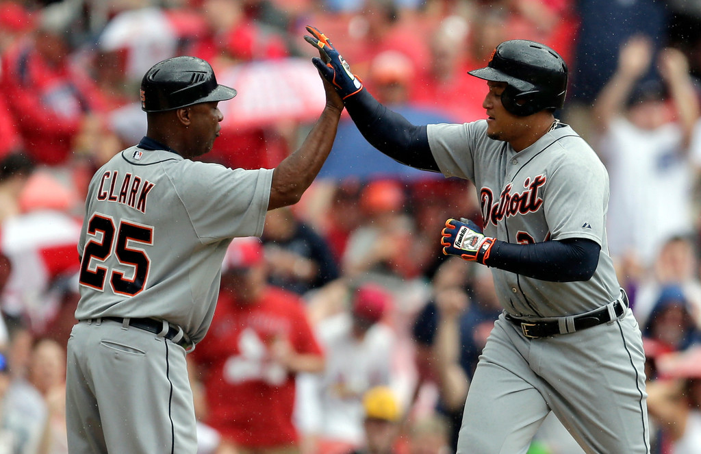 . Detroit Tigers\' Miguel Cabrera, right, is congratulated by third base coach Dave Clark after hitting a solo home run during the first inning of a baseball game against the St. Louis Cardinals, Saturday, May 16, 2015, in St. Louis. (AP Photo/Jeff Roberson)