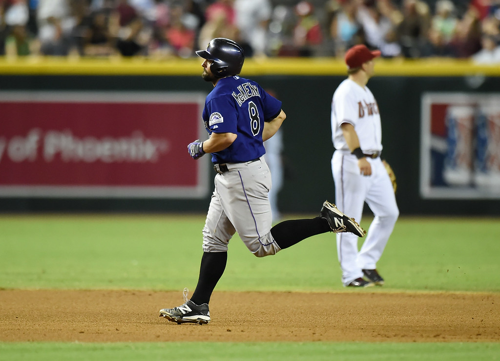 . Michael McKenry #8 of the Colorado Rockies rounds the bases after hitting a home run in the fifth inning against the Arizona Diamondbacks at Chase Field on August 8, 2014 in Phoenix, Arizona.  (Photo by Norm Hall/Getty Images)