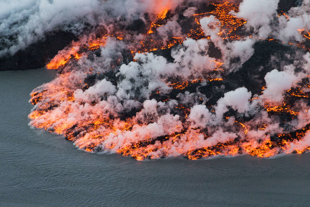 . An aerial picture taken on September 14, 2014 shows lava flowing out of the Bardarbunga volcano in southeast Iceland. The Bardarbunga volcano system has been rocked by hundreds of tremors daily since mid-August, prompting fears the volcano could explode. Bardarbunga, at 2,000 metres (6,500 feet), is Iceland\'s second-highest peak and is located under Europe\'s largest glacier, Vatnajoekull. BERNARD MERIC/AFP/Getty Images