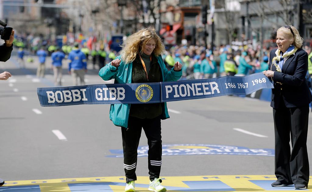 . Bobbi Gibb, first woman to run the Boston Marathon in 1966, crosses the finish line for photographers duirng the 120th Boston Marathon on Monday, April 18, 2016, in Boston. (AP Photo/Elise Amendola)