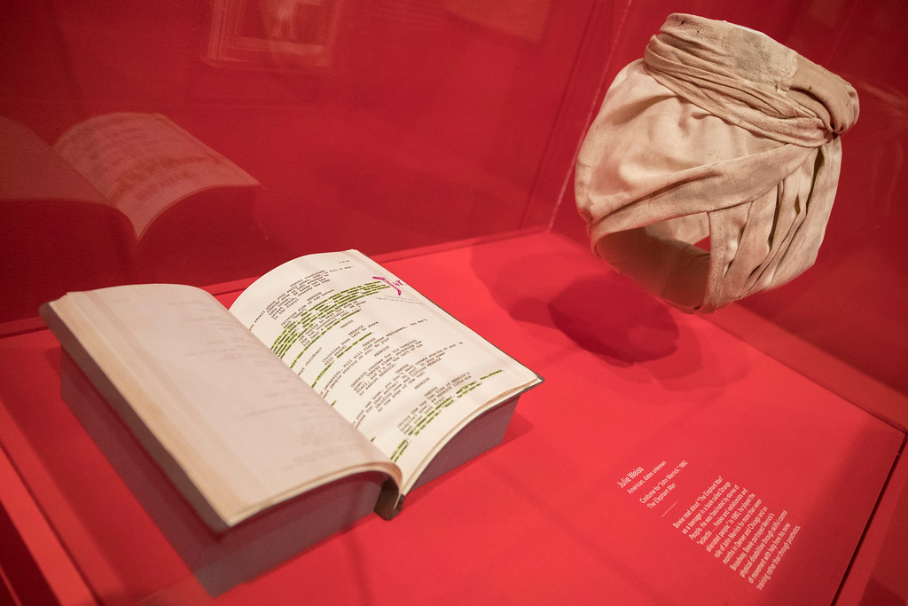 """. The script for the \""""Elephant Man\"""" with handwritten notes and the \""""John Merrick\"""" costume designed by Julie Weiss during the media preview of the \""""David Bowie is\"""" exhibit at the Brooklyn Museum, Wednesday, Feb. 28, 2018, in New York. The exhibit opens to the public March 2 and runs through July 15, 2018. (AP Photo/Mary Altaffer)"""