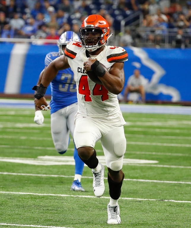 . Cleveland Browns defensive end Nate Orchard (44) returns an interception for a 64-yard touchdown during the first half of an NFL football preseason game against the Detroit Lions, Thursday, Aug. 30, 2018, in Detroit. (AP Photo/Rick Osentoski)