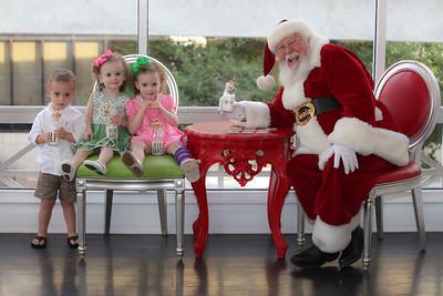 Kate, Eli and Ella-Grace meet Santa at Sweet Pete's Candy Shop
