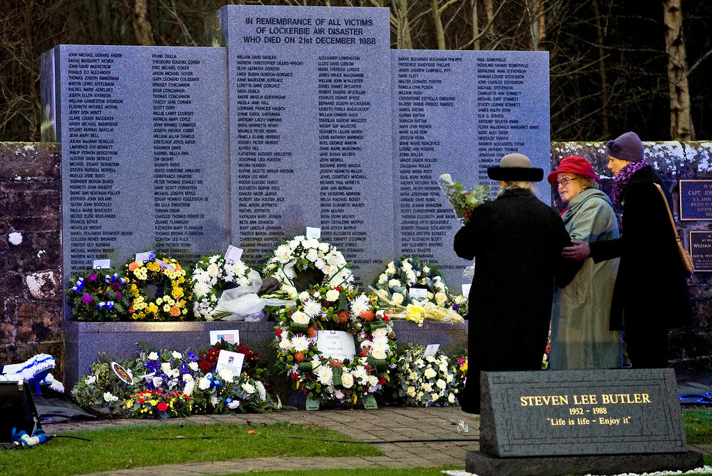 . Jane Schultz (L, back to camera) who lost her son Tom and and unidentified friends lay down flowers during a memorial ceremony at Dryfesdale Cemetery in Lockerbie, Scotland, 21 December 2013. Britain was due to mark the 25th anniversary of the Lockerbie bombing on 21 December, with memorials for the 270 victims being held in London and in the Scottish town where Pan Am flight 103 came crashing down following a terrorist attack. Pam Am flight 103 was flying from London to New York on 21 December 1988 when it exploded in the air and crashed onto Lockerbie, killing everyone on board and 11 people on the ground.  EPA/BRIAN STEWART