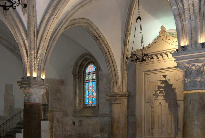 5-The Cenacle, room of the Last Supper. Gothic pillars, arches, and windows indicate a room built by Crusaders (early 14th century) on top of a much older structure. The original building was a synagogue, of which three walls still exist. The Crusaders church was destroyed in 1219. The Cenacle was spared, passing to the Friars until 1552. The Ottomans took possession and turned the room into a mosque (note window and mirhab).