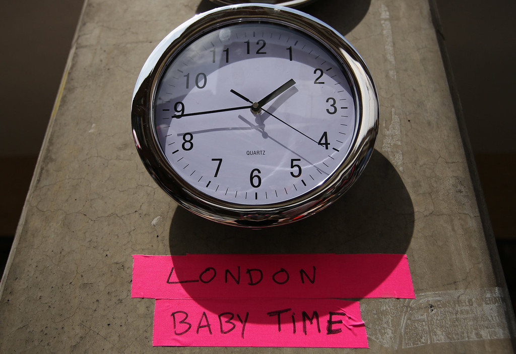 . A clock in the press pen shows the time outside the Lindo Wing of St Mary\'s Hospital, where Britain\'s Catherine, Duchess of Cambridge is due to give birth, in London July 15, 2013. The first child of Prince William and his wife Kate is due in mid-July, with the couple saying they have no idea of the sex of the baby, who will be third in line to the British throne.  REUTERS/Olivia Harris