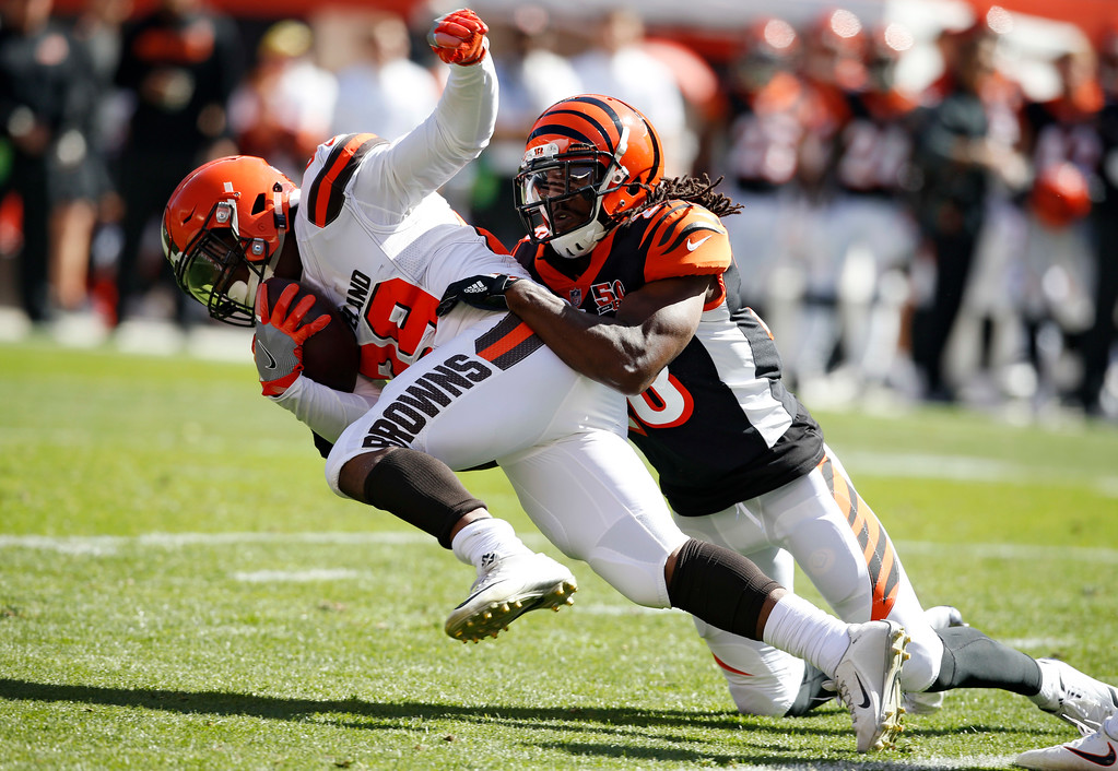 . Cleveland Browns running back Duke Johnson (29) is tackled by Cincinnati Bengals cornerback Josh Shaw (26) in the first half of an NFL football game, Sunday, Oct. 1, 2017, in Cleveland. (AP Photo/Ron Schwane)