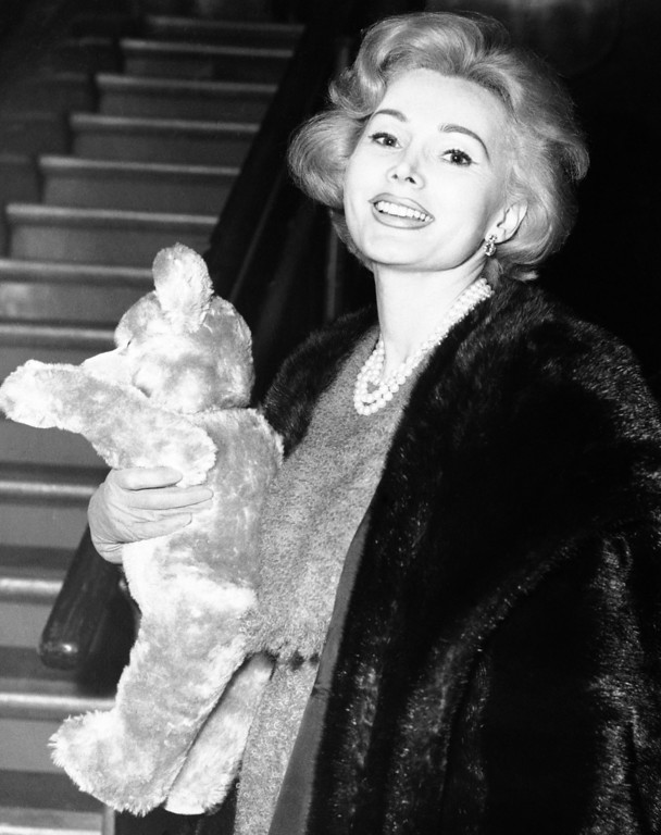 . Actress Zsa Zsa Gabor holds large teddy-bear when pictured on her arrival on Nov. 14, 1958 at London Airport from Berlin. (AP Photo)