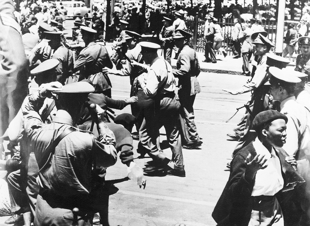 . Baton-wielding police break up the crowd outside the Drill Hall, in Johannesburg, South Africa, Dec. 31, 1956, as the \'Treason Trials\' opened. Nelson Mandela was among the people who were on trial. (AP Photo)