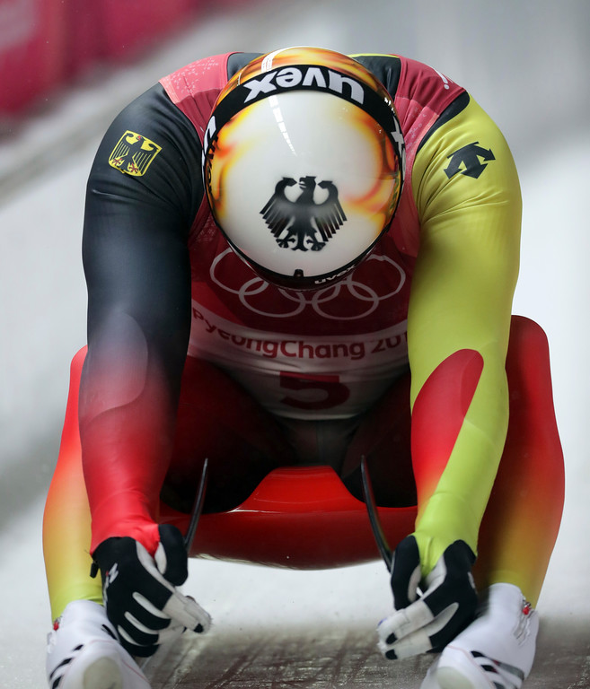 . Felix Loch of Germany sits dejected in the final area after losing his lead on the final run during the men\'s luge competition at the 2018 Winter Olympics in Pyeongchang, South Korea, Sunday, Feb. 11, 2018. (AP Photo/Michael Sohn)