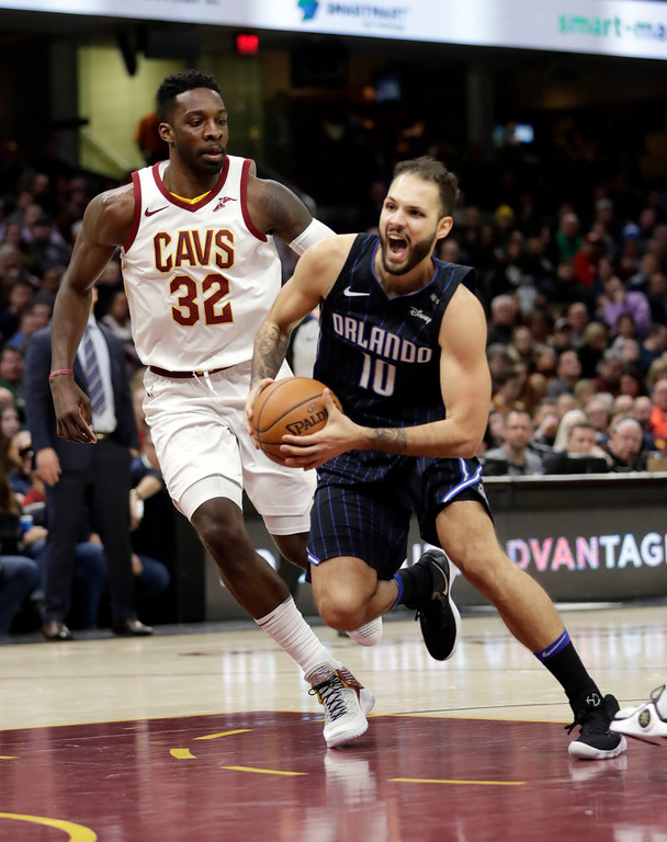 . Orlando Magic\'s Evan Fournier (10), from France, drives against Cleveland Cavaliers\' Jeff Green (32) in the second half of an NBA basketball game, Thursday, Jan. 18, 2018, in Cleveland. (AP Photo/Tony Dejak)