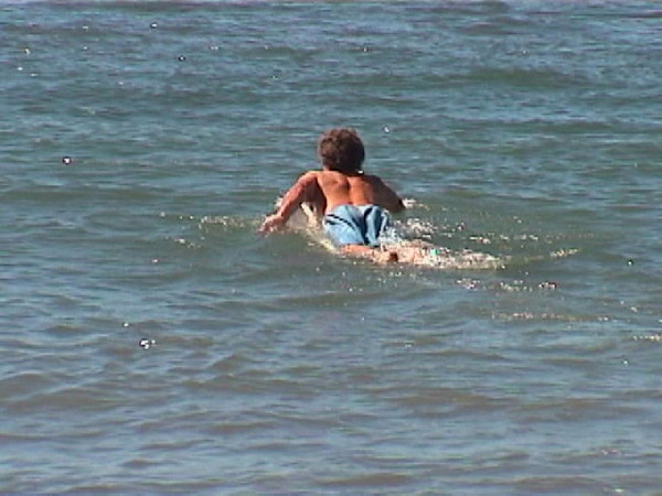 Tom paddling out.jpg