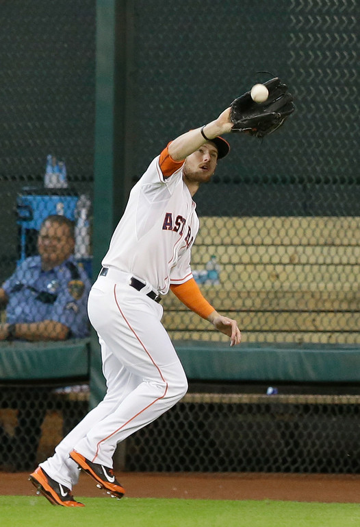 . Houston Astros center fielder Alex Presley makes the catch and the out on Detroit Tigers\' Rajai Davis in the first inning of a baseball game Saturday, June 28, 2014, in Houston. (AP Photo/Pat Sullivan)