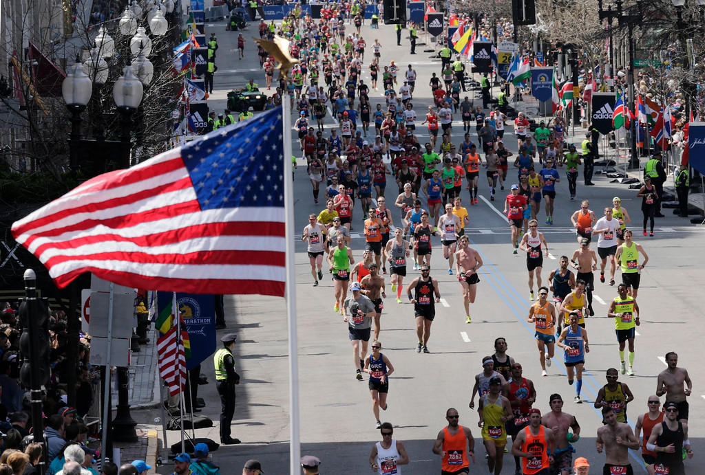 . Runners head to the finish line of the 120th Boston Marathon on Monday, April 18, 2016, in Boston. (AP Photo/Charles Krupa)