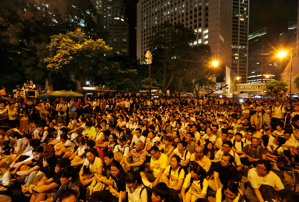 . Hundreds of protesters stage a peaceful sit-ins overnight on a street in the financial district in Hong Kong Wednesday, July 2, 2014, following a huge rally to show their support for democratic reform and oppose Beijing\'s desire to have the final say on candidates for the chief executive\'s job. (AP Photo/Kin Cheung)