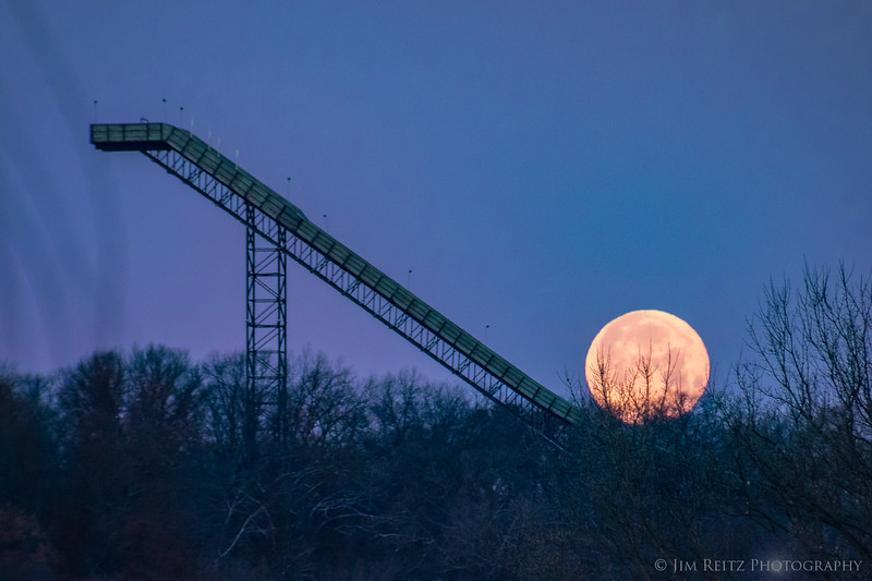 Super Moon rolling down a ski jump.